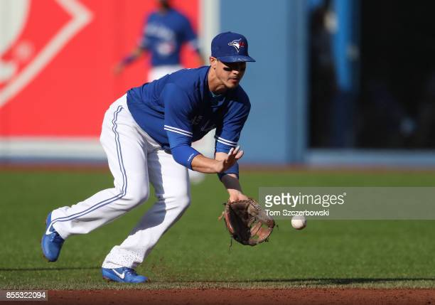 Darwin Barney of the Toronto Blue Jays makes the play and throws out the baserunner in the second inning during MLB game action against the New York...