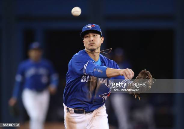 Darwin Barney of the Toronto Blue Jays makes the play and throws out the baserunner in the fifth inning during MLB game action against the Baltimore...