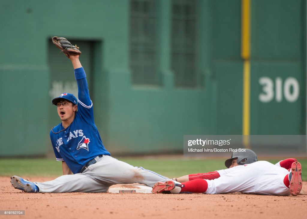 Darwin Barney #18 of the Toronto Blue Jays reacts after tagging out Mookie Betts #50 of the Boston Red Sox attempting to steal second base in the fifth inning at Fenway Park on July 20, 2017 in Boston, Massachusetts.