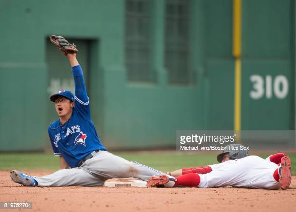 Darwin Barney of the Toronto Blue Jays reacts after tagging out Mookie Betts of the Boston Red Sox attempting to steal second base in the fifth...