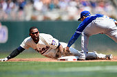 Darwin Barney of the Toronto Blue Jays tags out Eduardo Nunez of the Minnesota Twins at third base attempting to advance on a fly ball during the...