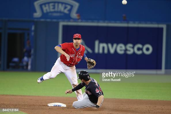 TORONTO ON JULY 1 Darwin Barney turns an inning ending double play to help Toronto Blue Jays second baseman Ryan Goins get out without giving up a...