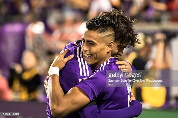 Darwin Ceren embraces teammate Ricardo Kaka of the Orlando City SC after Kaka scoredtheir third goal against the Portland Timbers at Citrus Bowl on...