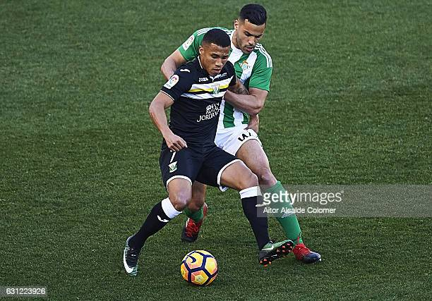 Darwin Daniel Machis of CD Leganes competes for the ball with Riza Durmisi of Real Betis Balompie during La Liga match between Real Betis Balompie v...
