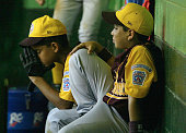 Darwin Huerta and Adis Portillo of Venezuela sit dejected in the dugout as they lose to Curacao during the Little League World Series on August 20...