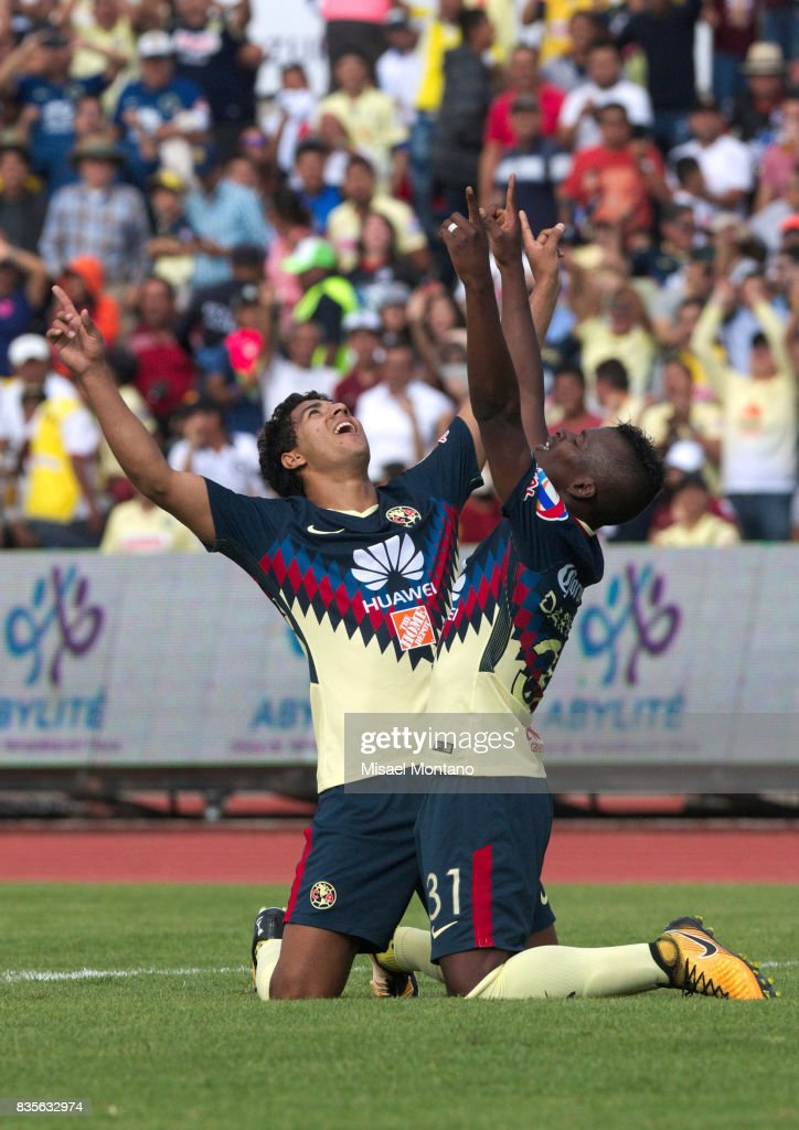 Darwin Quintero of America, celebrates with teammate Cecilio Dominguez after scoring the second goal of his team during the fifth round match between Lobos BUAP and America as part of the Torneo Apertura 2017 Liga MX at Olimpico de la BUAP Stadium on August 19, 2017 in Puebla, Mexico.
