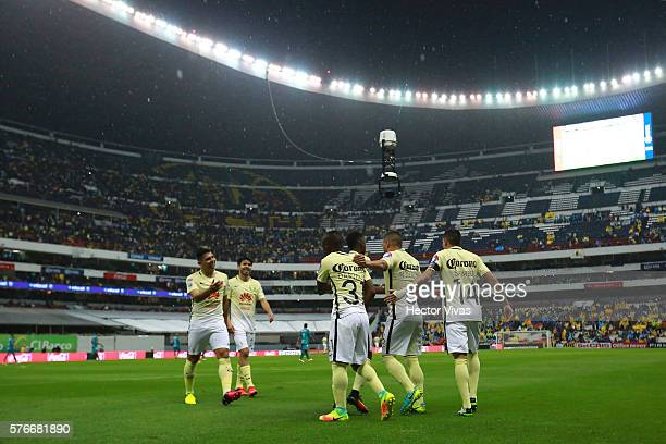 Darwin Quintero of America celebrates with teammates after scoring the first goal of his team during the 1st round match between America and Chiapas...