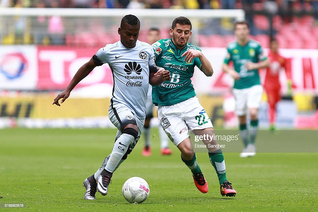 Darwin Quintero of America fights for the ball with Juan Cuevas of Leon during the 11th round match between America and Leon as part of the Clausura...