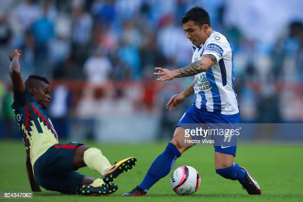 Darwin Quintero of America struggles for the ball with Edson Puch of Pachuca during the 2nd round match between Pachuca and America as part of the...