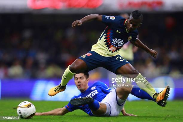Darwin Quintero of America struggles for the ball with Francisco Silva of Cruz Azul during the quarter finals second leg match between America and...