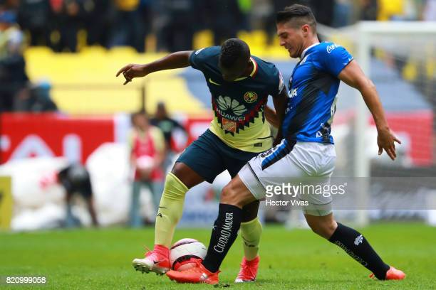 Darwin Quintero of America struggles for the ball with Javier Guemez of Queretaro during the 1st round match between America and Queretaro as part of...