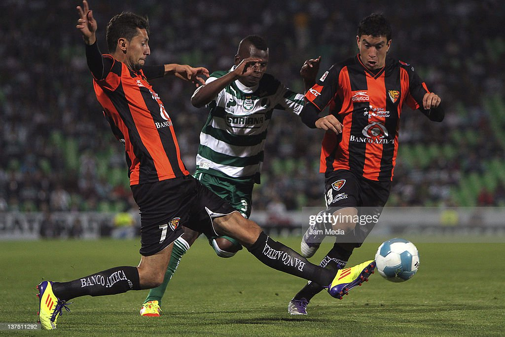 Darwin Quintero of Santos struggles for the ball with Yasser Corona and Jorge Rodriguez of Jaguares during a match between Santos v Jaguares at the...