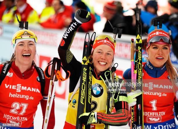 Darya Domracheva of Belarus celebrates silver Laura Dahlmeier of Germany celebrates gold and Gabriela Koukalova of the Czech Republic celebrates...