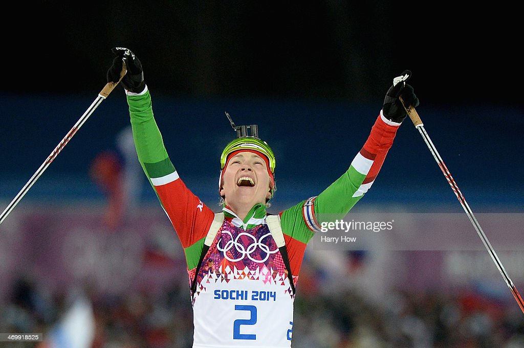 <a gi-track='captionPersonalityLinkClicked' href=/galleries/search?phrase=Darya+Domracheva&family=editorial&specificpeople=4105955 ng-click='$event.stopPropagation()'>Darya Domracheva</a> of Belarus celebrates winning gold medal after crossing the finish line during the Women's 12.5 km Mass Start during day ten of the Sochi 2014 Winter Olympics at Laura Cross-country Ski & Biathlon Center on February 17, 2014 in Sochi, Russia.