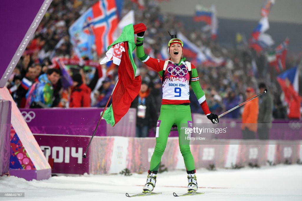 <a gi-track='captionPersonalityLinkClicked' href=/galleries/search?phrase=Darya+Domracheva&family=editorial&specificpeople=4105955 ng-click='$event.stopPropagation()'>Darya Domracheva</a> of Belarus celebrates winning the Women's 10 km Pursuit during day four of the Sochi 2014 Winter Olympics at Laura Cross-country Ski & Biathlon Center on February 11, 2014 in Sochi, Russia.