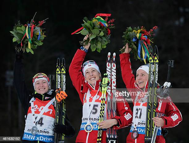 Darya Domracheva of Belarus third second place Fanny WelleStrand Horn of Norway first place and Tiril Eckhoff of Norway third place celebrate after...