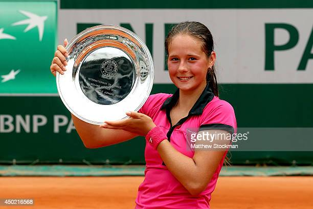 Darya Kasatkina of Russia poses with the trophy after her victory in the girls' singles final match against Ivana Jorovic of Serbia on day fourteen...