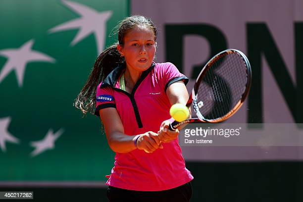 Darya Kasatkina of Russia returns a shot during the girls' singles final match against Ivana Jorovic of Serbia on day fourteen of the French Open at...