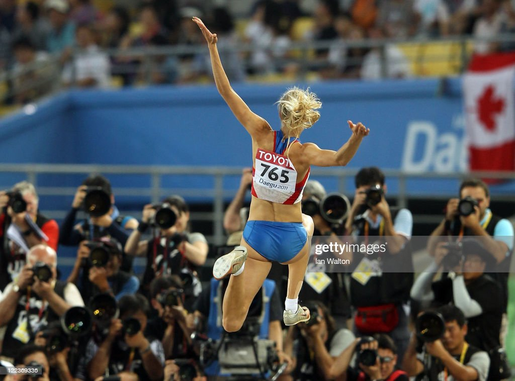 <a gi-track='captionPersonalityLinkClicked' href=/galleries/search?phrase=Darya+Klishina&family=editorial&specificpeople=4406149 ng-click='$event.stopPropagation()'>Darya Klishina</a> of Russia competes in front of the cameras in the women's long jump final during day two of the 13th IAAF World Athletics Championships at the Daegu Stadium on August 28, 2011 in Daegu, South Korea.
