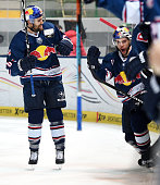 Daryl Boyle and Jerome Samson of EHC Red Bull Muenchen celebrate after scoring the 21 during the game between the EHC Red Bull Muenchen and Koelner...