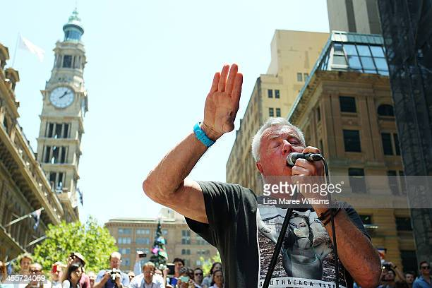 Daryl Braithwaite performs at the 'AIME Strut the Streets' parade in Martin Place on December 13 2013 in Sydney Australia The annual event raises...