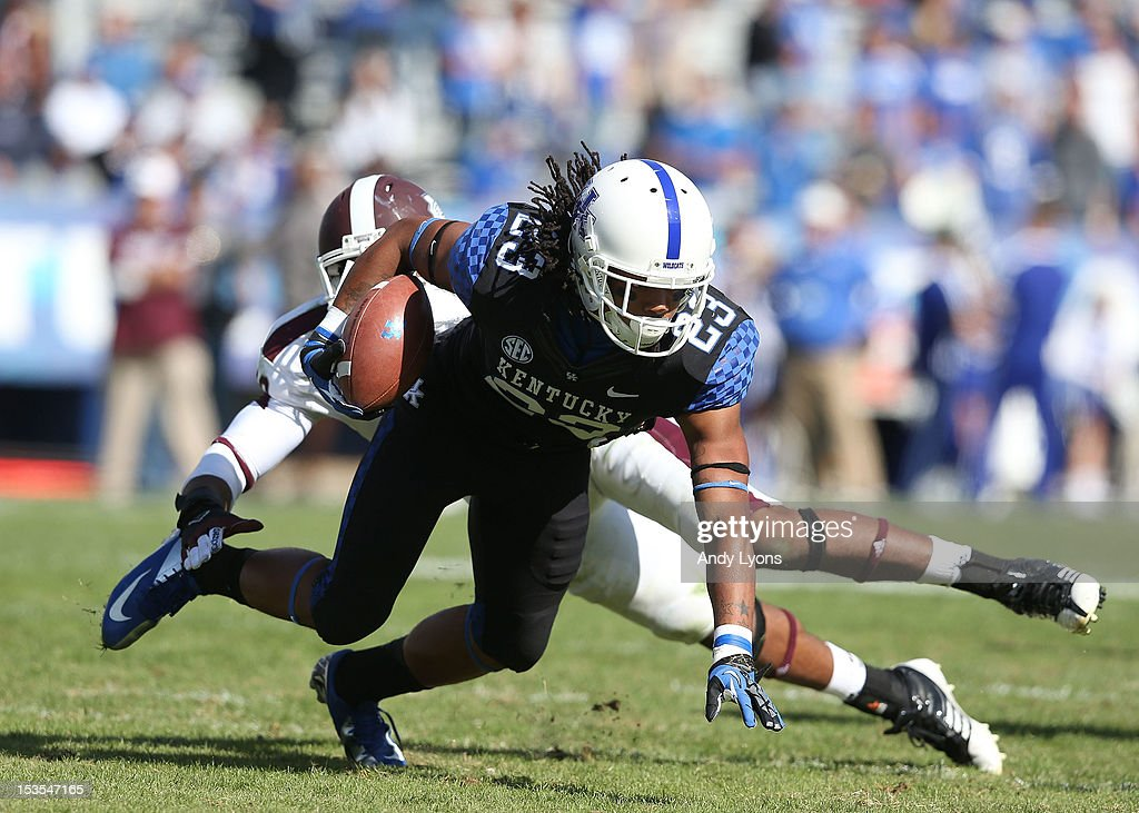 Daryl Collins #23 of the Kentucky Wildcats runs with the ball during the SEC game against the Mississippi State Bulldogs at Commonwealth Stadium on October 6, 2012 in Lexington, Kentucky.