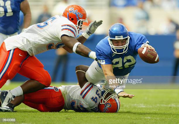 Daryl Dixon Ray McDonald of Florida take down quarterback Jared Lorenzen of Kentucky on September 27 2003 at Commonwealth Stadium in Lexington...