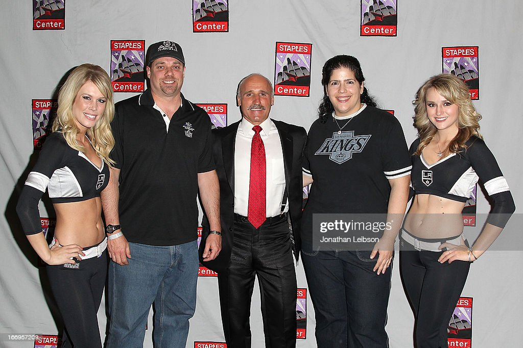 Daryl Evans (C) and The LA Kings Ice Crew pose with guests attend the LA Kings Chalk Talk & Game Experience at Staples Center on April 18, 2013 in Los Angeles, California.
