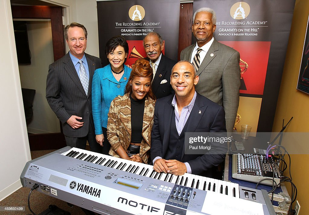 Daryl Friedman, VP, Adocacy and Government Relations at The Recording Academy, Rep. Judy Chu (D-CA), vocalist Chikk, Rep. John Conyers (D-MI), Grammy Award-winning American songwriter and record producer Harvey Mason, Jr. and Rep. Hank Johnson (D-GA) pose for a photo at the Holiday event with Harvey Mason, Jr. at The Recording Academy on December 4, 2013 in Washington, DC.