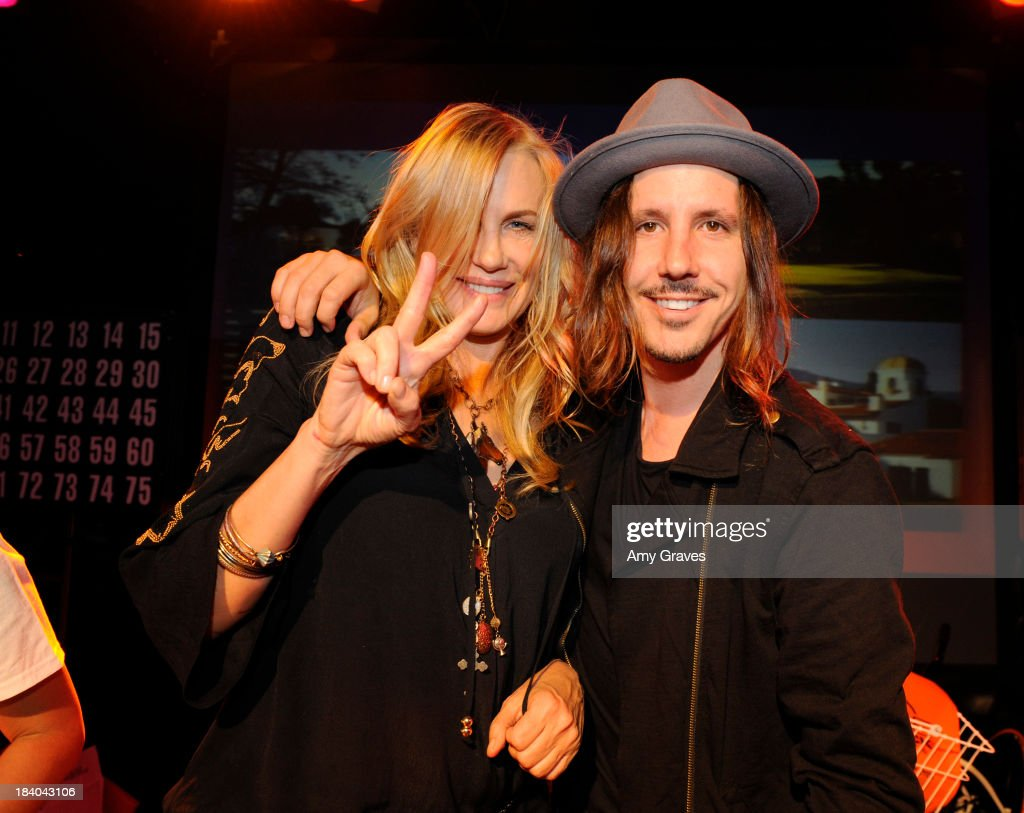 Daryl Hannah and Cisco Adler call Bingo at Bingo At The Roxy to Benefit The Painted Turtle at The Roxy Theatre on October 10, 2013 in West Hollywood, California.