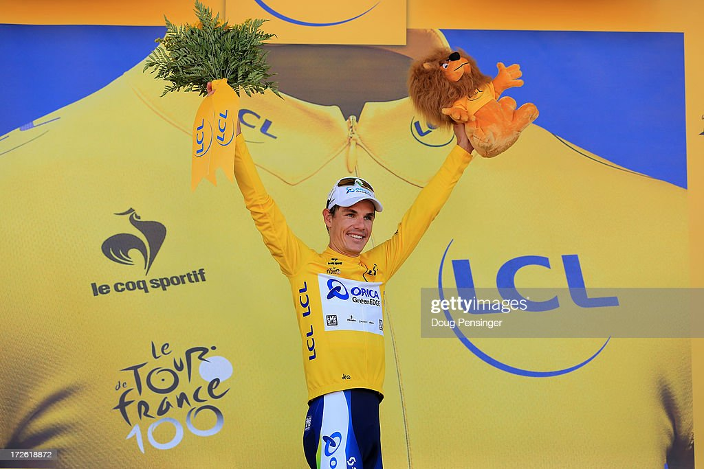 Daryl Impey of South Africa and Orica Greenedge celebrates with the yellow jersey following stage six of the 2013 Tour de France, a 176.5KM road stage from Aix-en-Provence to Montpellier, on July 4, 2013 in Montpellier, France.