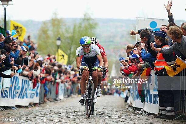 Daryl Impey of South Africa and Orica GreenEDGE rides up the Kwaremont during the 98th Tour of Flanders from Bruges to Oudenaarde on April 6 2014 in...