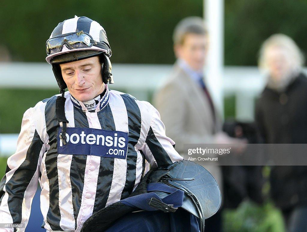 Daryl Jacob looks dejected at Kempton Park racecourse on January 11, 2014 in Sunbury, England.