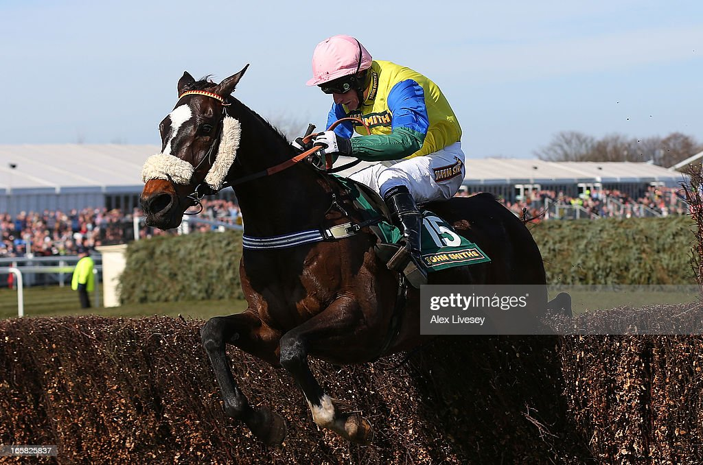 Daryl Jacob rides Battle Group to victory during the John Smith's Handicap at Aintree Racecourse on April 6, 2013 in Liverpool, England.