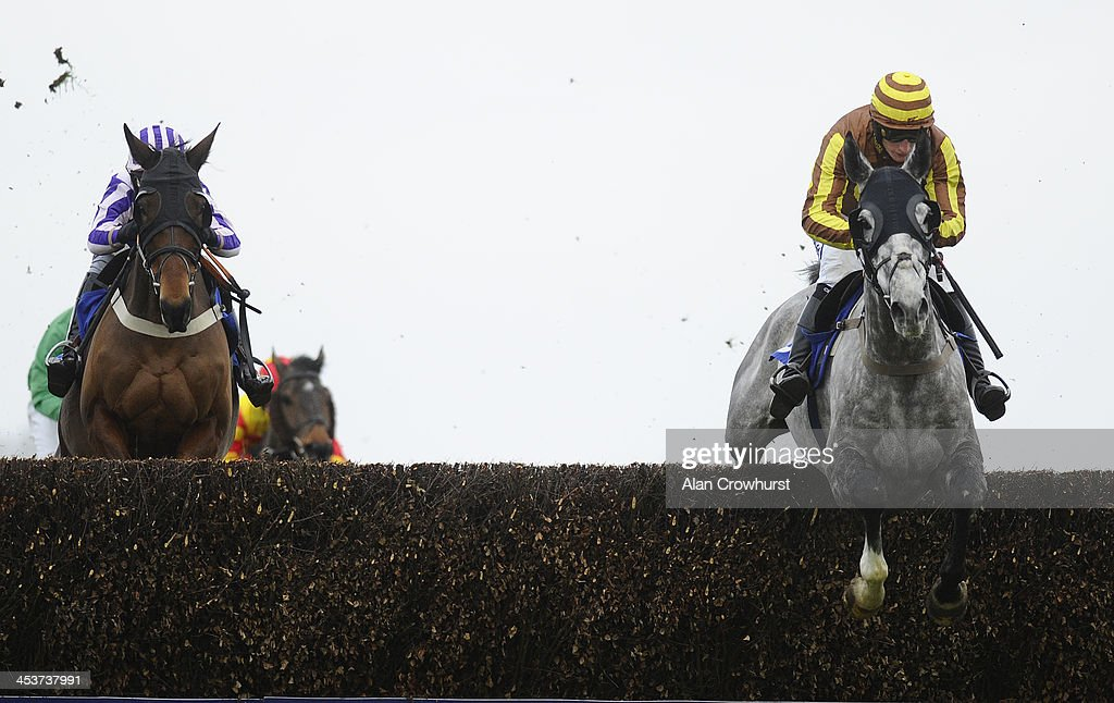 Daryl Jacob riding Buck's Bond (R) on their way to winning The Weatherbys Hamilton Insurance Silver Buck Handicap Steeple Chase at Wincanton racecourse on December 05, 2013 in Wincanton, England.