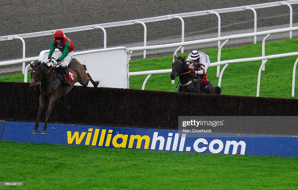 Daryl Jacob riding Dodging Bullets clear the last to win The Wiliam Hill - In The App Store Beginners' Steeple Chase at Kempton Park racecourse on October 20, 2013 in Sunbury, England.