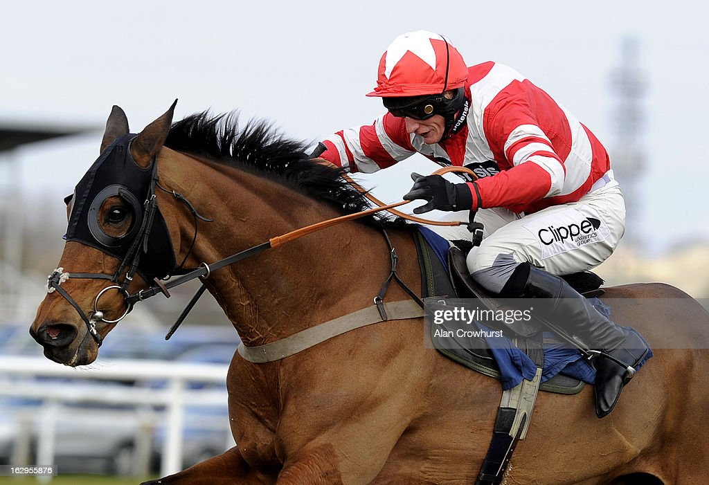 Daryl Jacob riding Michel Le Bon clear the last to win The Barbury International Supporting Greatwood Veterans' Handicap Steeple Chase at Newbury racecourse on March 02, 2013 in Newbury, England.