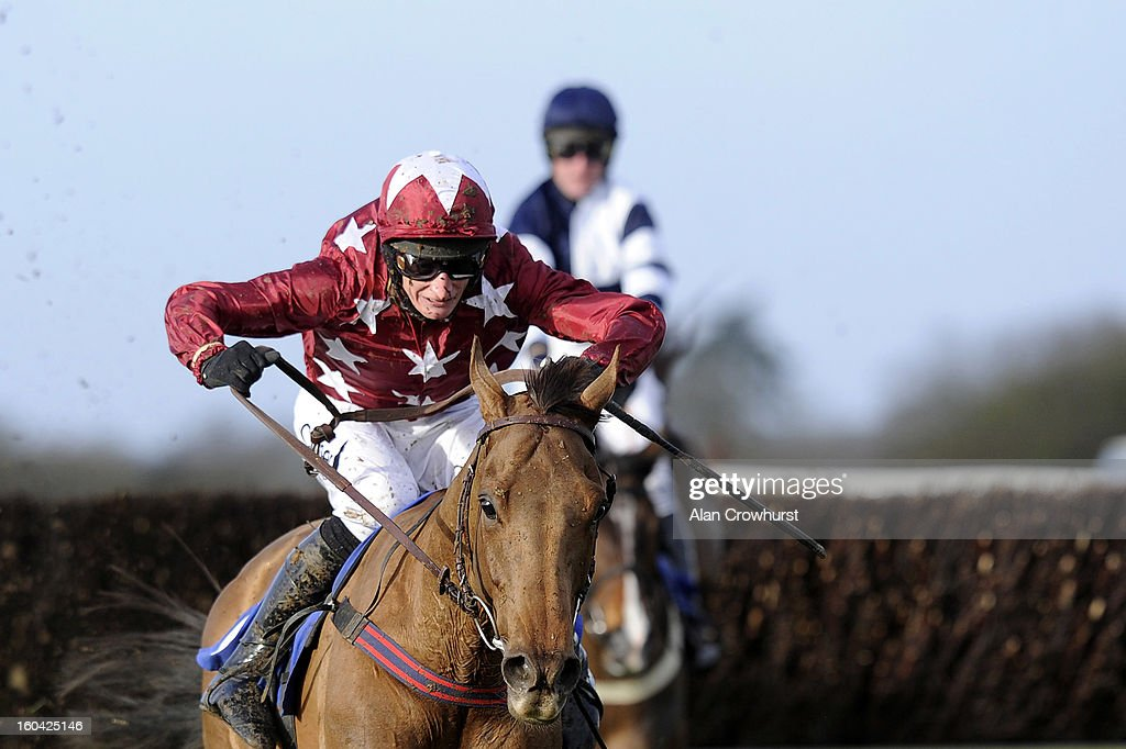 Daryl Jacob riding Politeo clear the last to win The Grolsch Handicap Steeple Chase at Wincanton racecourse on January 31, 2013 in Wincanton, England.