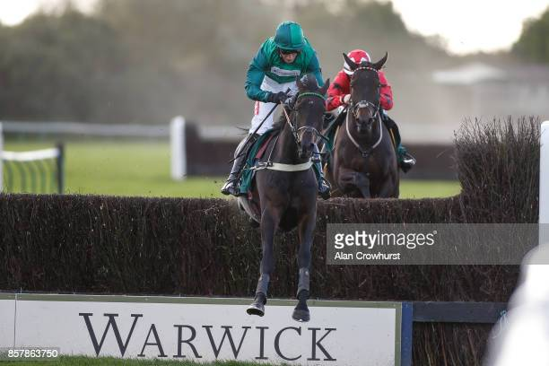 Daryl Jacob riding Sceau Royal clear the last to win The Bet At racingukcom Novices Steele Chase at Warwick racecourse on October 5 2017 in Warwick...
