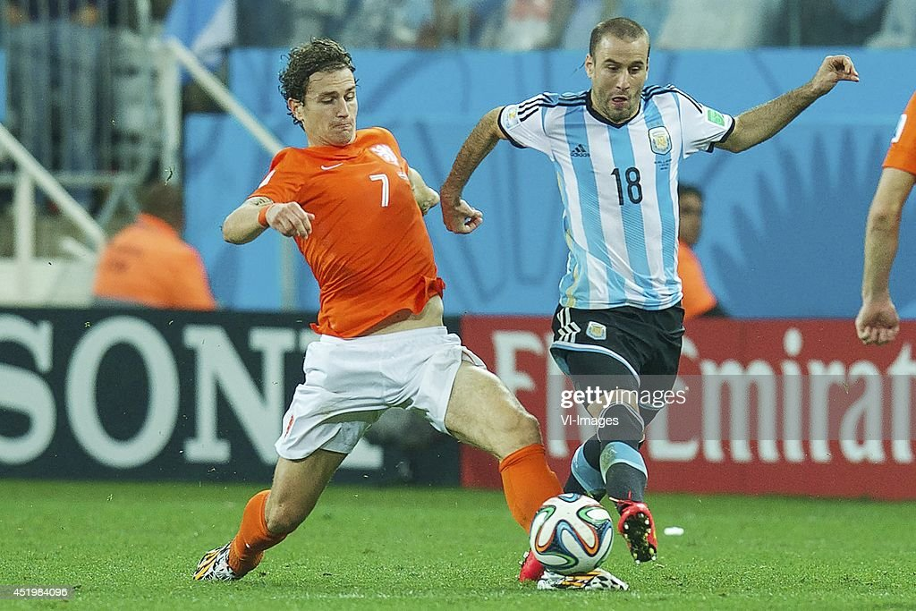 Daryl Janmaat of Holland, Rodrigo Palacio of Argentina during the match between The Netherlands and Argentina on July 9, 2014 at Arena de Sao Paulo in Sao Paulo, Brazil.