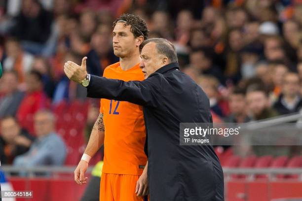 Daryl Janmaat of Netherlands and head coach Dick Advocaat of Netherlands gesture during the FIFA 2018 World Cup Qualifier between Netherlands and...