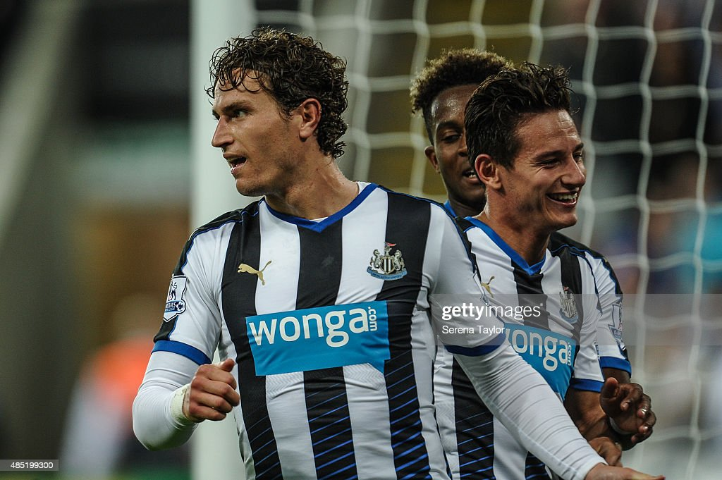 Daryl Janmaat (L) of Newcastle celebrates with teammates Rolando Aarons (Partially hidden) and Florian Thauvin (R) after scoring the third goal for Newcastle during The Capital One Cup second round match between Newcastle United and Northampton Town at St.James Park on August 25, 2015, in Newcastle upon Tyne, England.
