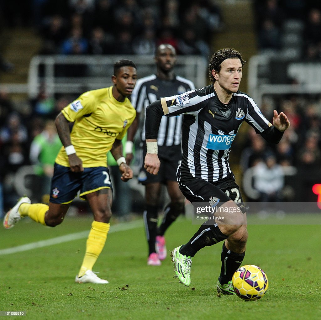 Daryl Janmaat of Newcastle runs with the ball during the Barclays Premier League match between Newcastle United and Southampton at St.James' Park on January 17, 2015, in Newcastle upon Tyne, England.