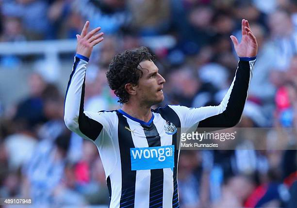 Daryl Janmaat of Newcastle United celebrates scoring his team's first goal during the Barclays Premier League match between Newcastle United and...