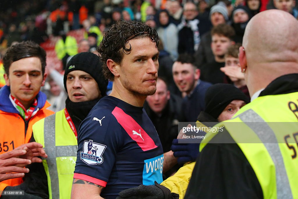 Daryl Janmaat of Newcastle United is confronted by unhappy Newcastle fans after the Barclays Premier League match between Stoke City and Newcastle United at the Britannia Stadium on March 2, 2016 in Stoke on Trent, England.