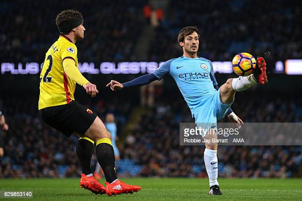 Daryl Janmaat of Watford and David Silva of Manchester City during the Premier League match between Manchester City and Watford at Etihad Stadium on...