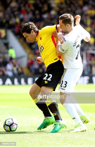 Daryl Janmaat of Watford and Gylfi Sigurdsson of Swansa City battle for possession during the Premier League match between Watford and Swansea City...