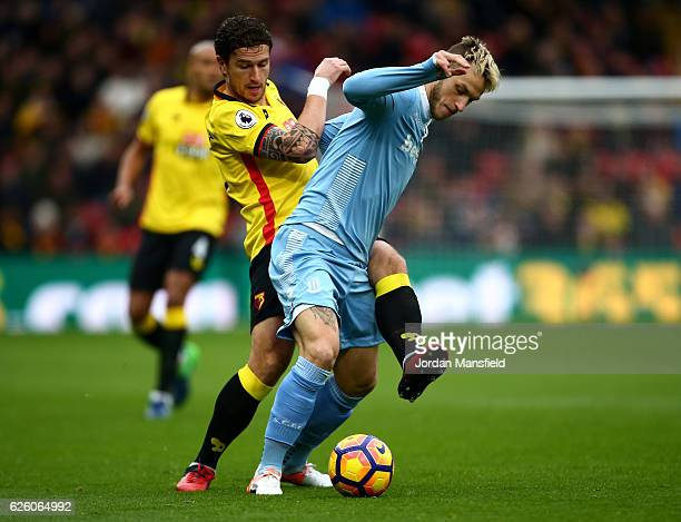 Daryl Janmaat of Watford and Marko Arnautovic of Stoke City battle for possession during the Premier League match between Watford and Stoke City at...