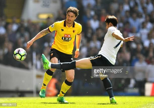 Daryl Janmaat of Watford attempts to takke the ball past HeungMin Son of Tottenham Hotspur during the Premier League match between Tottenham Hotspur...