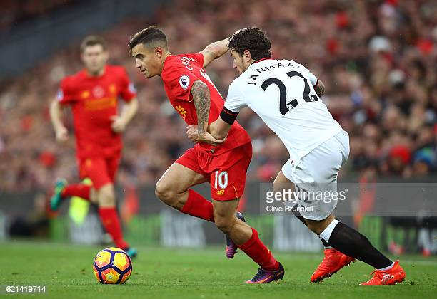 Daryl Janmaat of Watford chases Philippe Coutinho of Liverpool during the Premier League match between Liverpool and Watford at Anfield on November 6...